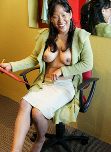 Busty Asian babe Tiana with puffy nipples is sitting on the chair