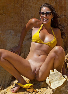 Petria in yellow bikini and big clit at the rocks