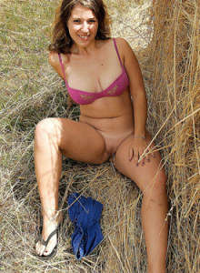 Exciting busty Jana outside in the field and the hay