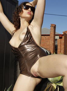 Tight bronze shiny spandex girl Anne Melb with cameltoe and puffy nipples