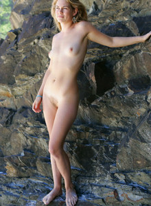 Exciting young hairy pussy goddess Seriya nude on the rock