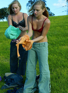 Blonde twins Rochelle and Shae dressing in the field