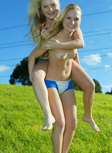 Playful young twins Rochelle and Shae dressed tight in the field but dare to be nude