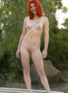 Redhead Marion sitting on the bentch in tight blue jeans and then stripping to show the pink panties with cameltoe