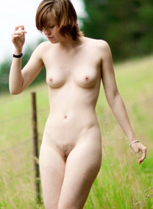 Joanna running on the field in jeans and going nude with puffy nipples and hairy vagina