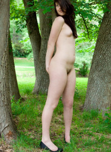 Harper outside dressed in long dress standing on the wooden bridge and then hidding in the trees as she is shy and topless before going nude as she wears see-through panties covering hairy pussy