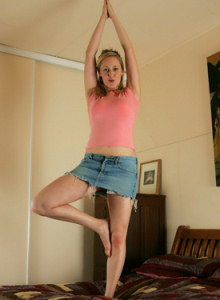 Flexible Erin with big boobs dressed in pink top and jeans skirt with yellow underwear and panties cameltoe