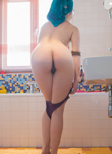 Apple ass Emilia with hairy bush is dressing in the bathroom