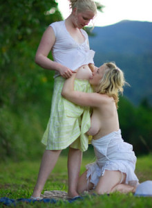 Two girlfriends busty Anneke and Sue Ann outside in white dresses showing nude hairy pussies