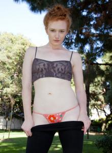 Redhead Bree Abernathy in black spandex yoga
