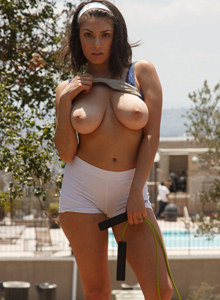 Big boobs Darcie Dolce is jumping in tight blue top and white shorts with cameltoe