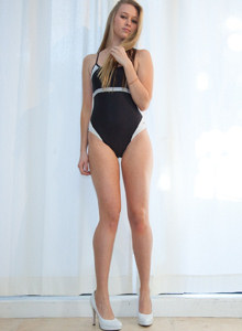 Kerstin Dorsia in tight black swimsuit