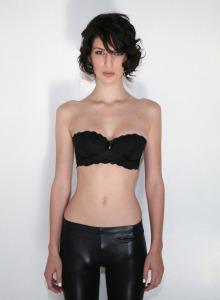 Hot brunette Molly Berardi wearing black lycra