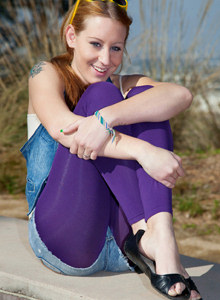 Lizzy London is outside in magenta spandex
