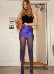 Perfect beauty Nicole Wetzel is dressed tight in magenta skirt with magenta pantyhose and high heels