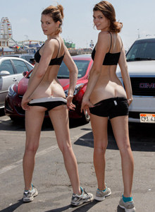 Romi and Raylene twins beach fitness in tight black petite suits