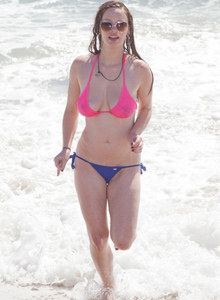 Sweet brunette Natalie Moore is sexy in the sea and on the beach wearing blue and pink bikini