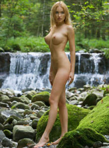 Satin doll Lia is nude at the waterfall