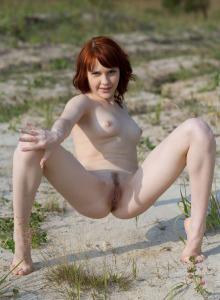 Redhead cutie Ragni nude outdoor