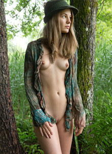 Nastya is nude in the forest with stretching nipples