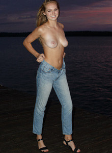 Young topless busty beauty Ellen Kennedy is at the lake shore in sexy dark bikini and blue jeans