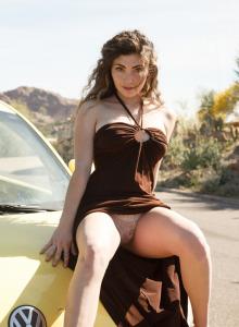 Beautiful Gillian Barnes flashing big boobs public in brown summer dress