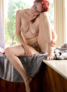 Big tits redhead hottie Ren in pink underwear with panties cameltoe goes nude to show her hairy bush