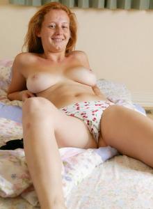 Busty redhead Jacinta dressed in black