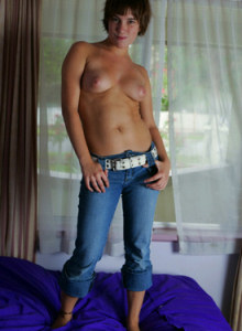 Busty Yellena in tight blue jeans and pink underwear with panties cameltoe is dancing on the bed
