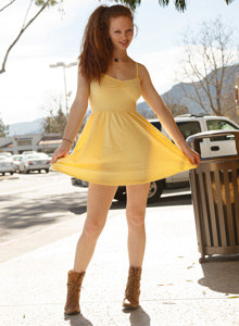 Exciting busty redhead Wendy Patton is flashing public wearing sunny dress
