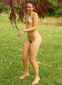 Exciting Maya outside climbing a tree and going nude to show her hairy slut