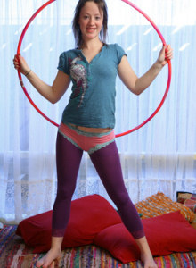 Melita tight clothed in dark magenta pantyhose plays with hula hoop and gets pink panties cameltoe on her hairy slut