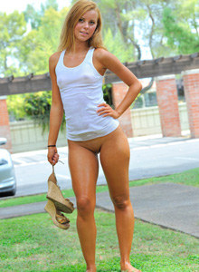 Tasty young blonde Jessi in the backyard in tight white t-shirt and jeans shorts