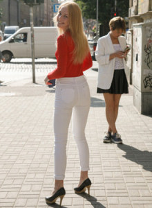 Young hot sexy blonde beauty Rune Kimele walking in white jeans in the city